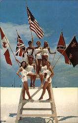 Fiesta of Five Flags, Seven Women Posed on Lifeguard Chair with Flags