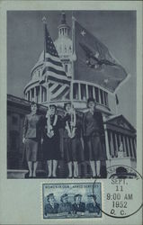 Four Women in Uniforms Holding Two Flags near Capitol Building