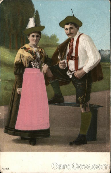 Man and Woman Dressed in Decorative Clothing Silk & Fabric Applique