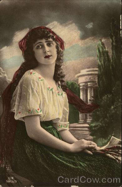 Young Woman in a White Blouse and Green Skirt Women