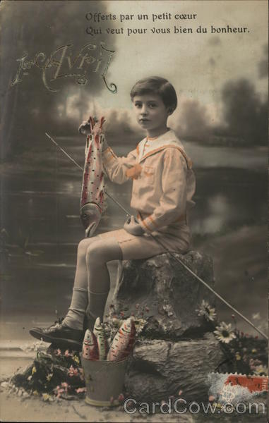 A young boy holding a fish and a fishing pole April Fools Day