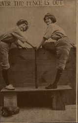 Women in Baseball Uniforms Straddling Fence