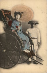 Japanese Woman in Rickshaw Holding Umbrella Near Man Wearing Hat