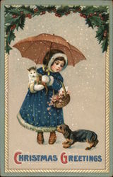 Girl with Umbrella Holding Cat and Basket in the Snow