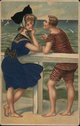 A Man in a Bathing Suit talking to a Woman in a Blue Dress
