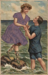 A Man Helping A Woman Across Rocks