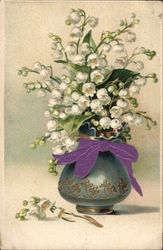 White Flowers in a Blue Vase tied with a purple ribbon