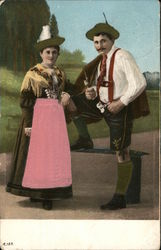 Man and Woman Dressed in Decorative Clothing