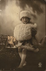 Young Girl Dressed in Fur with Giant Muff