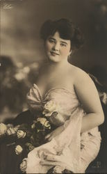 Dark-Haired Woman in Formal Gown with Roses