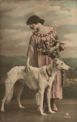 Woman in Pink Beside Large White Dog
