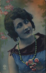 Young Woman With Brown Hair Wearing Green Necklace