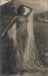 Nude Woman in Field Wearing See-Through Garment