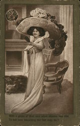 Woman Holding Small Mirror Wearing Huge Hat