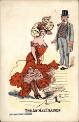 Woman in Red Dress Holding Whip as Man Looks at Her