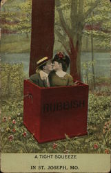 Couple in Box Marked Rubbish Kissing