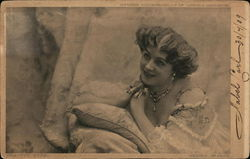 """Beauty's Eyes"" Lying on Pillows Wearing Necklace Postcard"