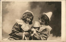 Two Little Girls and a Cat all Wearing Hats