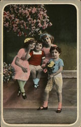Four Children Near Flowering Bush