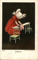 Little Girl in a red dress and white bonnet ironing