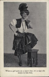 Woman Holding a Drink, Wearing a Stack of Men's Hats Postcard
