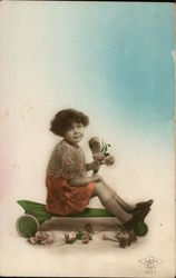 Girl, Seated, Holding Flowers