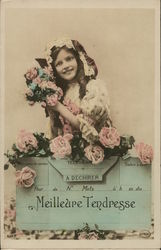 Girl Decked in Roses Standing Behind a Piece of Mail