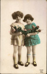 Two Little Girls holding Bouquets of Flowers