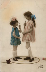 Two Young Girls Facing Each Other, Index Fingers Extended