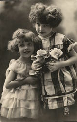 Two Young Girls Holding Roses