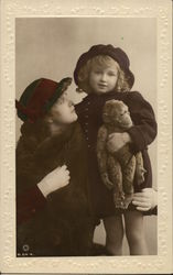 Woman with Her Arm Around a Little Girl with stuffed Monkey