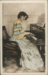 A Woman Sitting at a Piano
