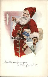 Santa wishes you a Merry Christmas - Santa holding presents