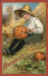 Boy Sitting on Hay Cutting Pumpkin Face