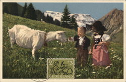 Two Children on Mountainside with Goat