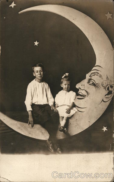 Two Youngsters Seated on Paper Moon Waterloo Iowa Moons