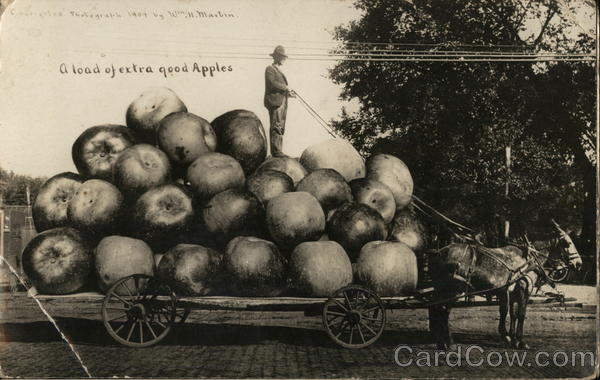 Farmer Standing on Pile of Giant Apples on a Cart Hawkeye Iowa