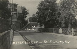 International Boundary - Derby Line, VT U.S.A. and Rock Island, QC Canada Postcard