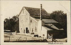 Barn with Two Men Standing on Front Deck