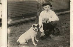Boy Holding White Dog on Leash