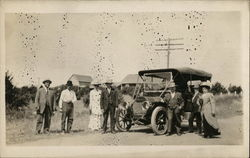 Men and Women Posing in Front of Automobile