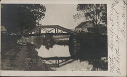 Reflections: Mirror Image of Bridge and Trees in Water