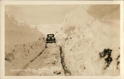 Long Valley Road - Car Traveling Down Narrow Snowy Road