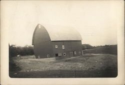 Large Newer Looking Barn Near Pasture and Trees