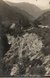 Scene at Cold Brook Camp - Aerial View of Road Through Mountains