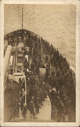 Ship With Sailors Crowded on Deck