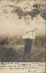 Young Boy Holding Toy Pistol