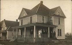 Two-Story Home with Group on Porch