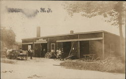 People Standing Near Wagon, Wheels and One-Story Structure