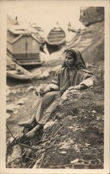 Indian Woman Sitting on the Ground, Boats in the Background